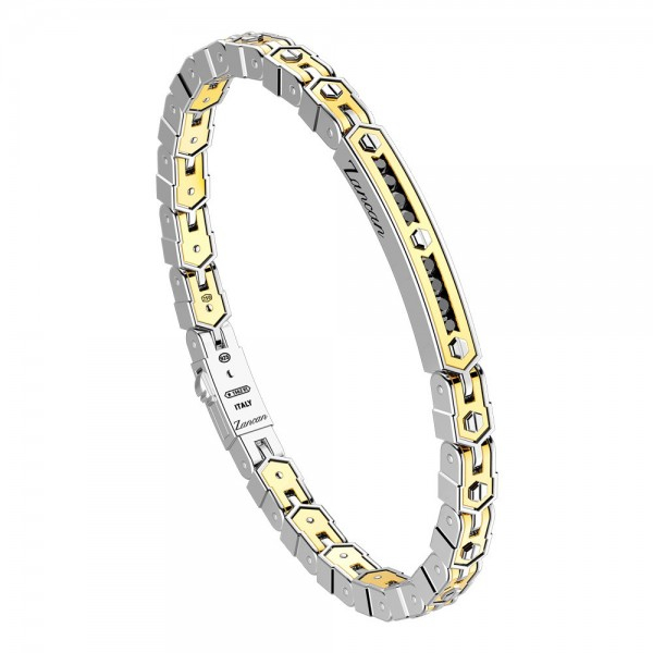 Gold and silver bracelet with plaque and spinels.