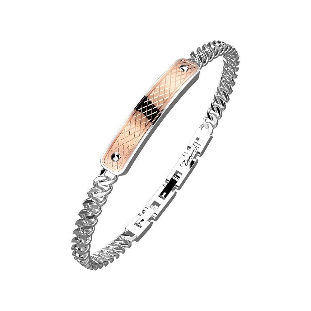 Bracciale in acciaio a grumetta con placca color rosa.