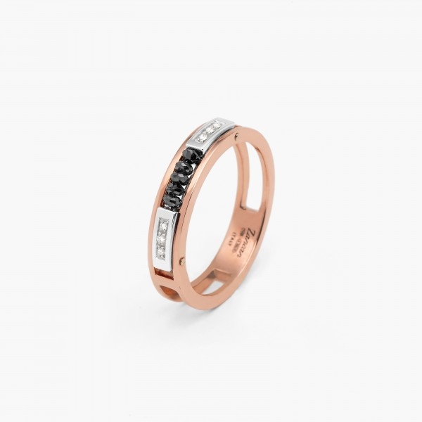 Rose gold men's ring with geometric design. Black diamonds in the middle, embellished with white gold details and white diamonds