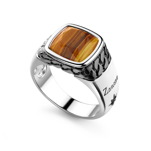 White and black silver ring...